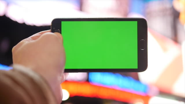 smart phone tablet computer isolated with green screen. urban people city background - isolated colour stock videos & royalty-free footage