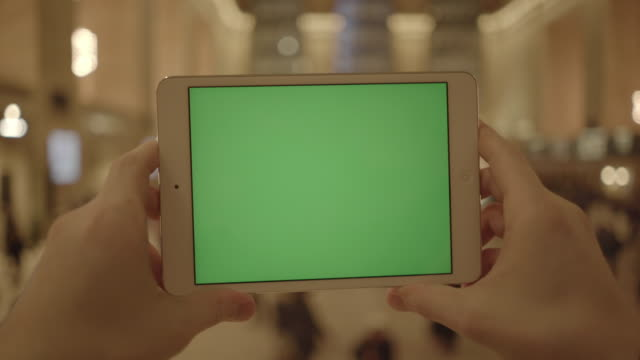 smart phone tablet computer isolated with green screen. urban people city background - colore isolato video stock e b–roll