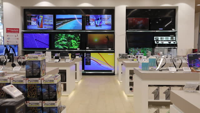 vidéos et rushes de smart televisions on display inside the aliexpress plaza retail store, operated by alibaba group holding ltd, inside the finestrelles shopping center... - electrical equipment