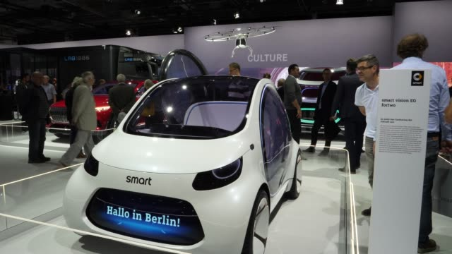 smart vision eq fortwo car stands among vehicles on display at the annual daimler ag shareholders meeting on may 22, 2019 in berlin, germany. daimler... - annual general meeting stock videos & royalty-free footage