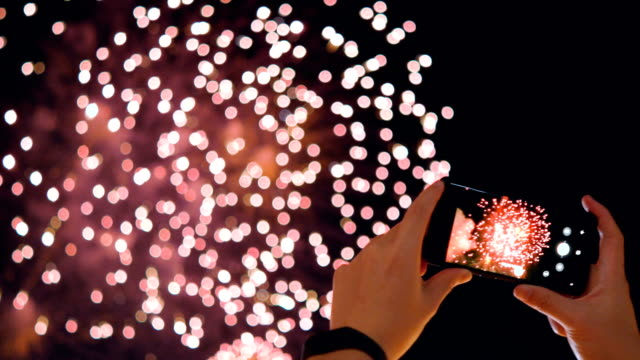 smartphone and fireworks. - holiday event stock videos & royalty-free footage