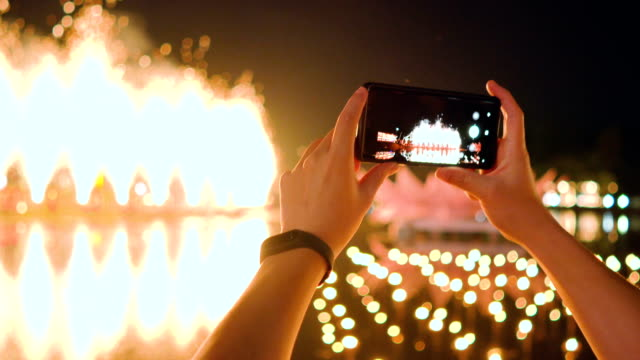 smartphone and fireworks. - filming stock videos and b-roll footage