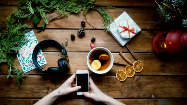 smartphone and wireless headphones on the christmas decorated table - flat lay stock videos & royalty-free footage