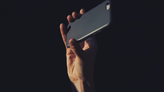 smartphone at concert - filming stock videos and b-roll footage
