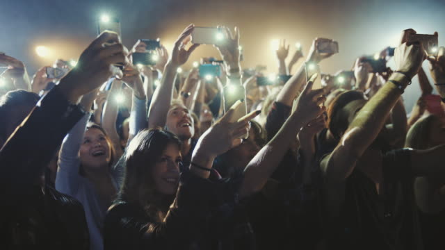 smartphone at concert - smart phone video stock e b–roll