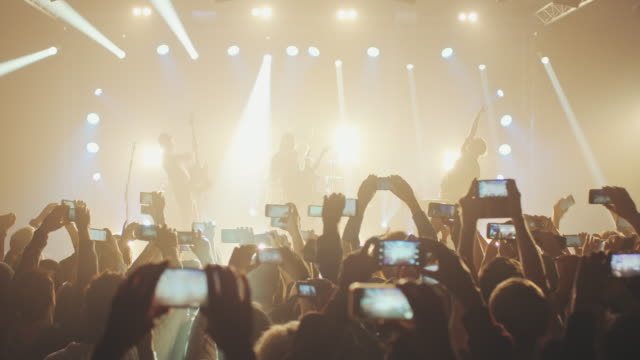 smartphone at concert - concert stock videos and b-roll footage