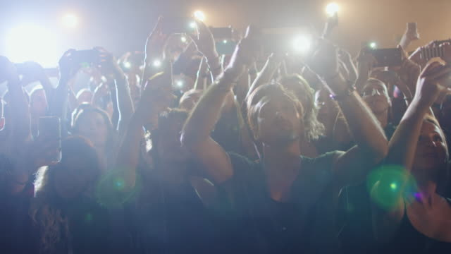smartphone at concert - spot lit stock videos and b-roll footage