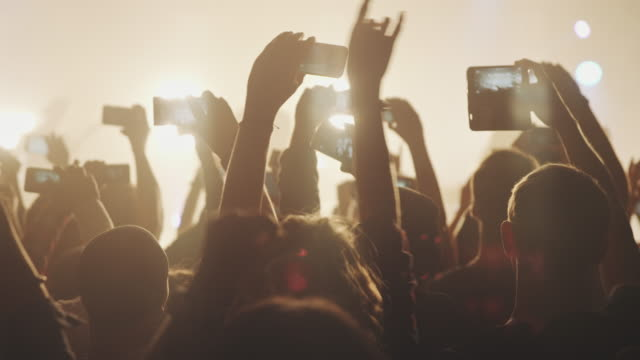 smartphone at concert - crowd stock videos & royalty-free footage