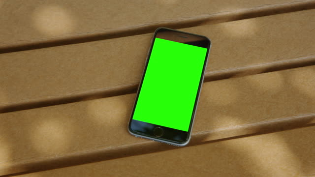 Smartphone bench shadow green screen chromakey mobile