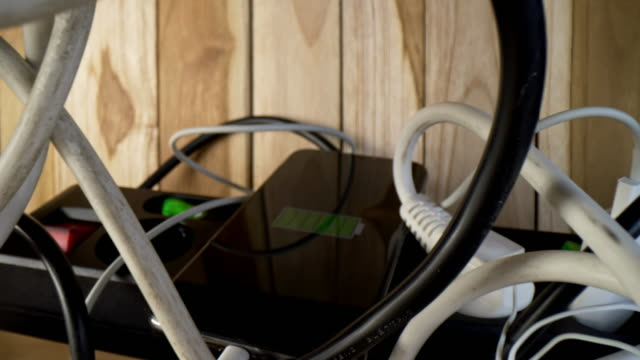 ds smartphone charging among tangled cables - tangled stock videos & royalty-free footage