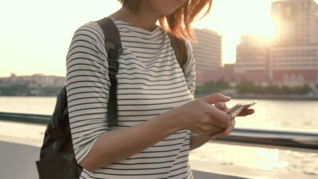 Smartphone girl outdoors