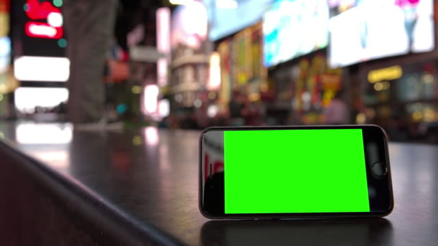 Smartphone mobile crowd Time Square people green screen chromakey NYC