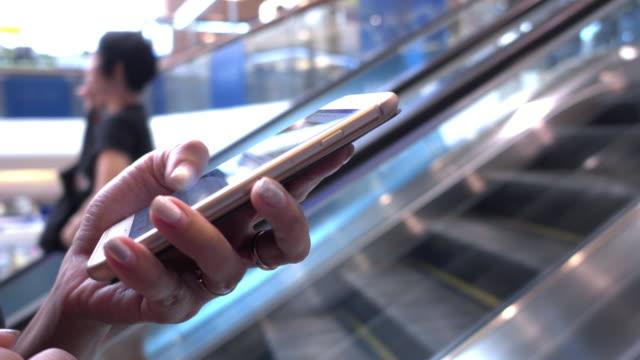 smartphone on escalator