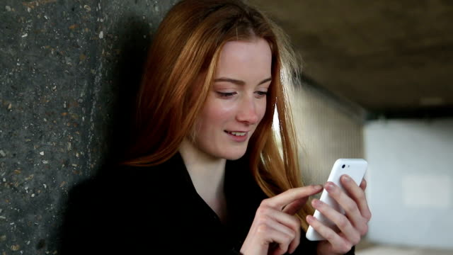 smartphone urban girl. red hair. - internet dating stock videos and b-roll footage