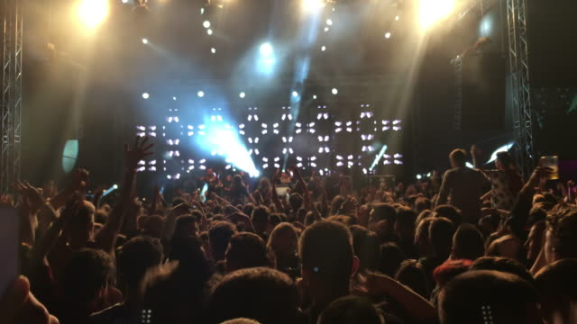smartphone video of a crowd enjoying a concert - live event stock videos & royalty-free footage