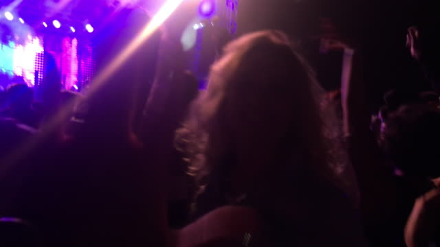 smartphone video of people dancing at concert at night - waving stock videos & royalty-free footage