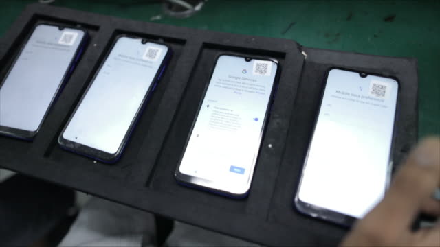 smartphones manufacturing at lava international factory in noida, uttar pradesh, india, on tuesday, september 22, 2020. - composition stock videos & royalty-free footage