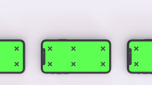 smartphones with blank green screen - blank screen stock videos & royalty-free footage