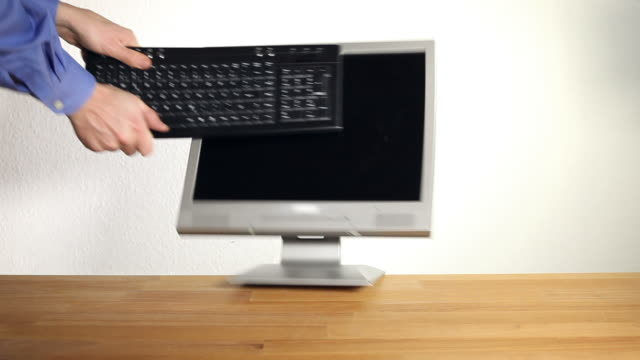 Smashing a computer - 2 clips