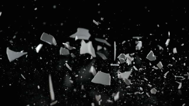 SLO MO of smashing a white plate on a table