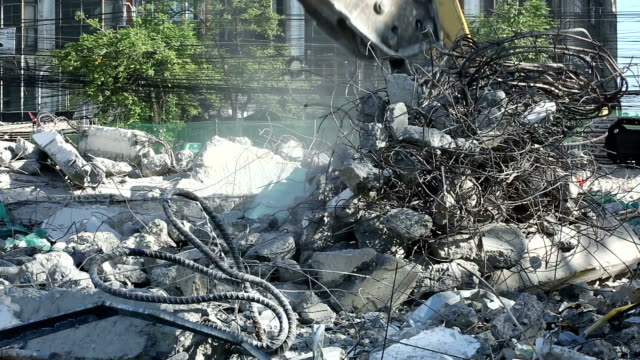 smashing concrete and disposal of construction building waste with heavy machinery - rubble stock videos & royalty-free footage