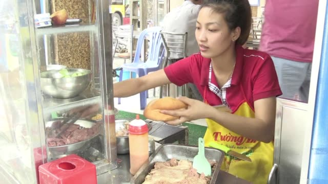 smeared with pate and loaded with fresh coriander and cucumber or just enjoyed with a pat of fresh butter banh mi are a delicious symbol of vietnam's... - coriander stock videos & royalty-free footage