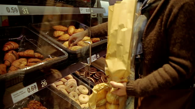 smelling  pastry for breakfast - dolci video stock e b–roll