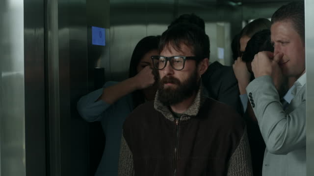 smelly man in an elevator - smelling stock videos and b-roll footage