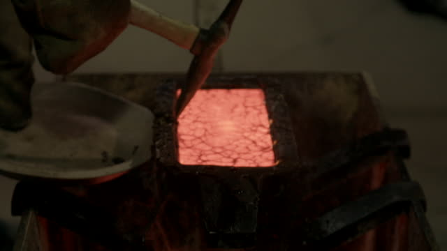 smelting gold in ingot mold - molten stock videos and b-roll footage