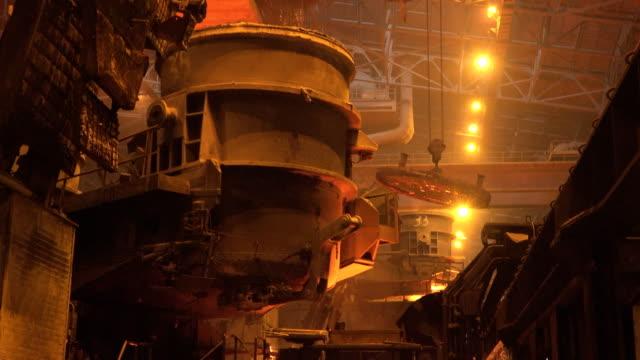 smelting metal at metallurgical factory floor - iron metal stock videos & royalty-free footage