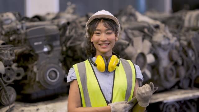 smile female industrial engineer in factory - metal industry stock videos & royalty-free footage