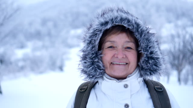 Smiled senior woman in winter nature