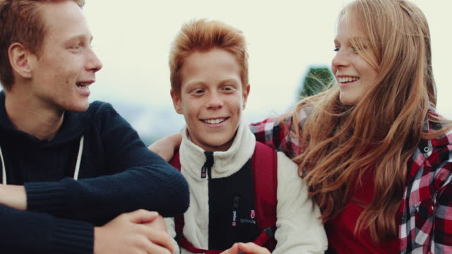 Smiles and looks: brothers and sister together slow motion