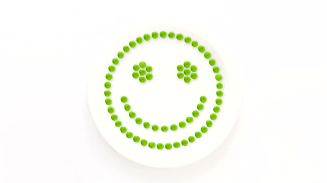 Smiley face made with peas