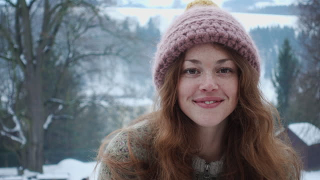 smiley portrait of a beautiful woman in winter - freckle stock videos & royalty-free footage