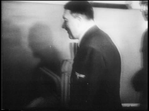 smiling adolf hitler visiting bandaged patient in hospital / newsreel - 1945 stock videos & royalty-free footage