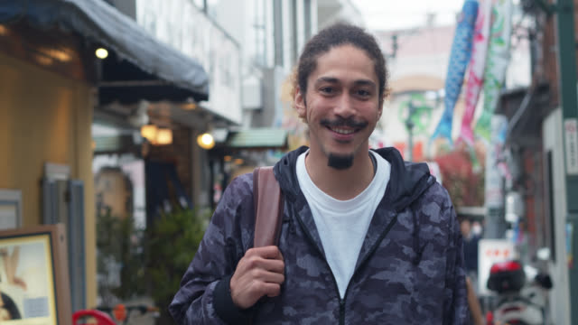 smiling african-american man on japanese street - moustache stock videos & royalty-free footage