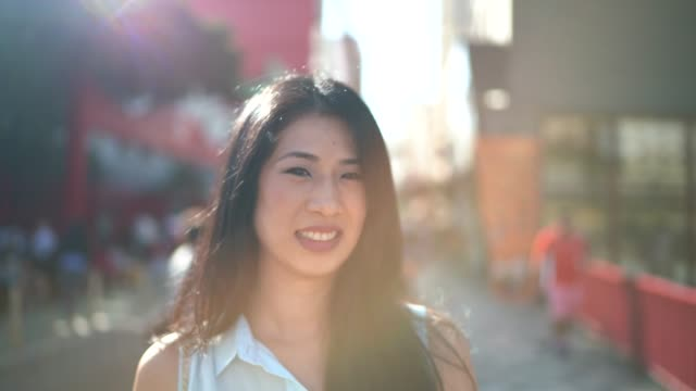 smiling asian woman portrait in the city - only mid adult women stock videos and b-roll footage