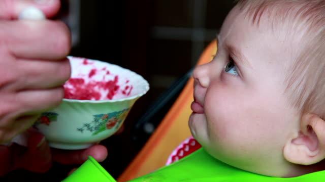 smiling baby eating beetroot salad - beet stock videos & royalty-free footage