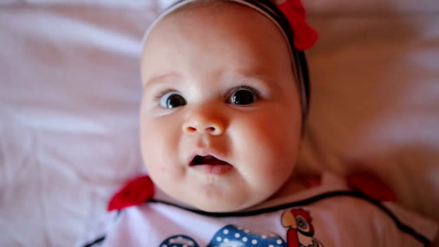 smiling baby girl ,close up - lying on back stock videos & royalty-free footage