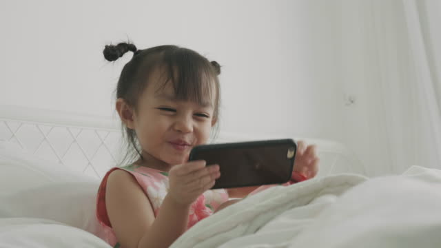 smiling baby girl using smart phone - cute stock videos & royalty-free footage