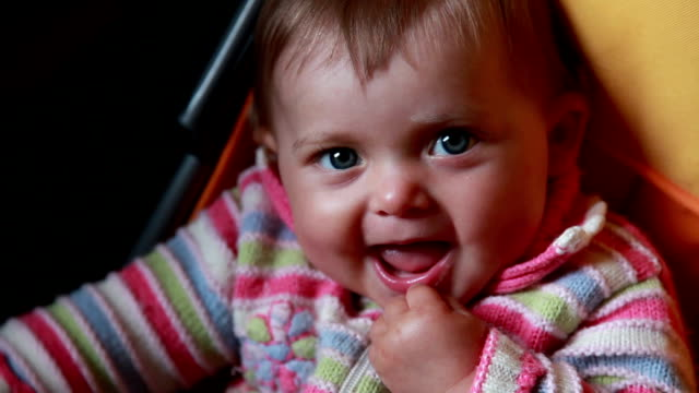 smiling baby looking at camera - part of a series stock videos & royalty-free footage