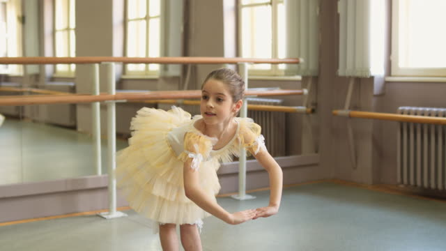 smiling ballerina practicing at ballet studio - tutu stock videos & royalty-free footage