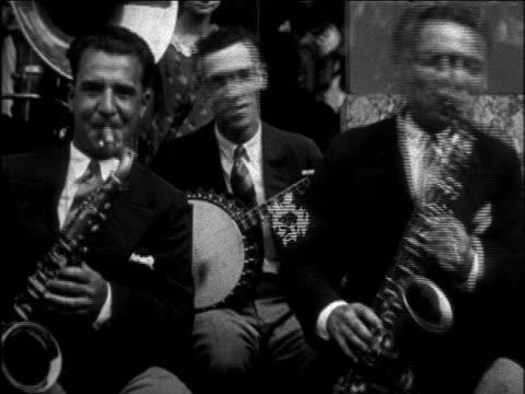 b/w 1926 smiling banjo + saxophone players playing + smiling / newsreel - 1926 stock videos & royalty-free footage