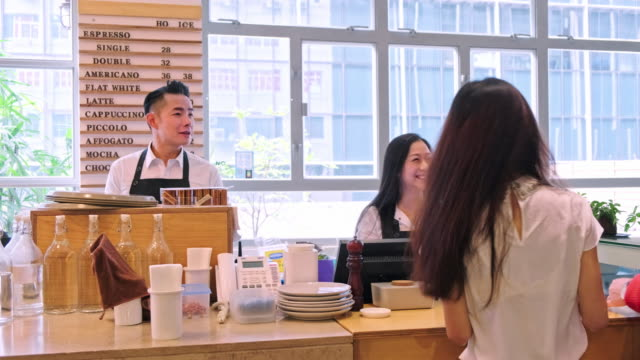 smiling barista taking order from customers - cafeteria worker stock videos and b-roll footage