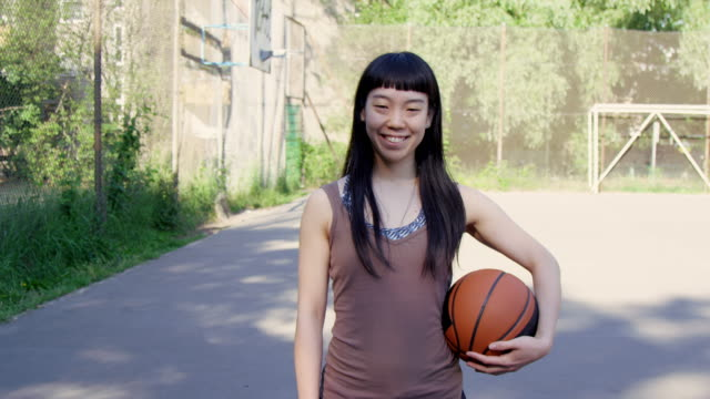 smiling basketball player with ball on court - skill stock videos & royalty-free footage
