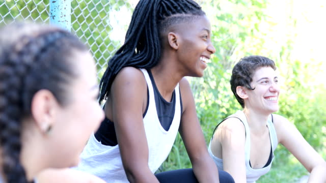 smiling basketball player with friends at court - dreadlocks stock videos & royalty-free footage