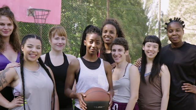 smiling basketball team standing on sports court - plus size model stock videos & royalty-free footage