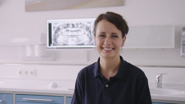 smiling beautiful female dentist in medical clinic - 35 39 years stock videos & royalty-free footage