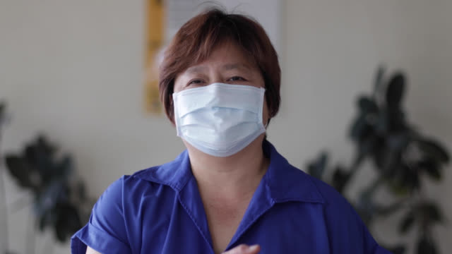smiling behind the mask - malaysian culture stock videos & royalty-free footage